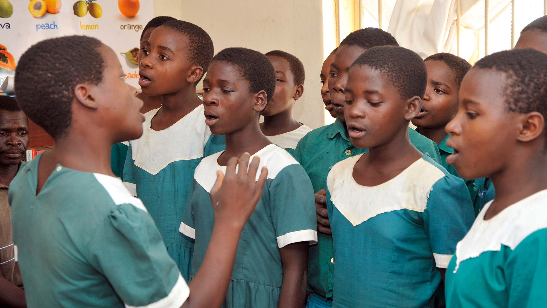 Malawian girl conducting a singing girl's choir