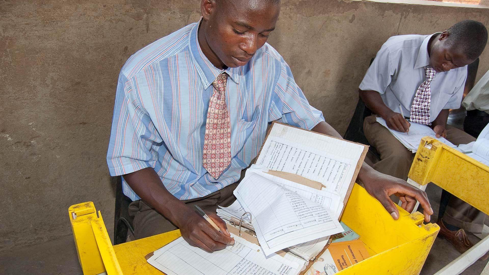 Malawian children doing homework at desks