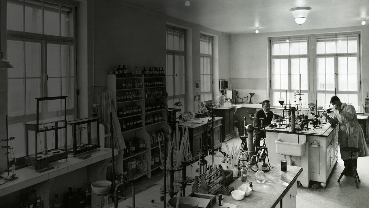 Two scientists working in an early industrial lab