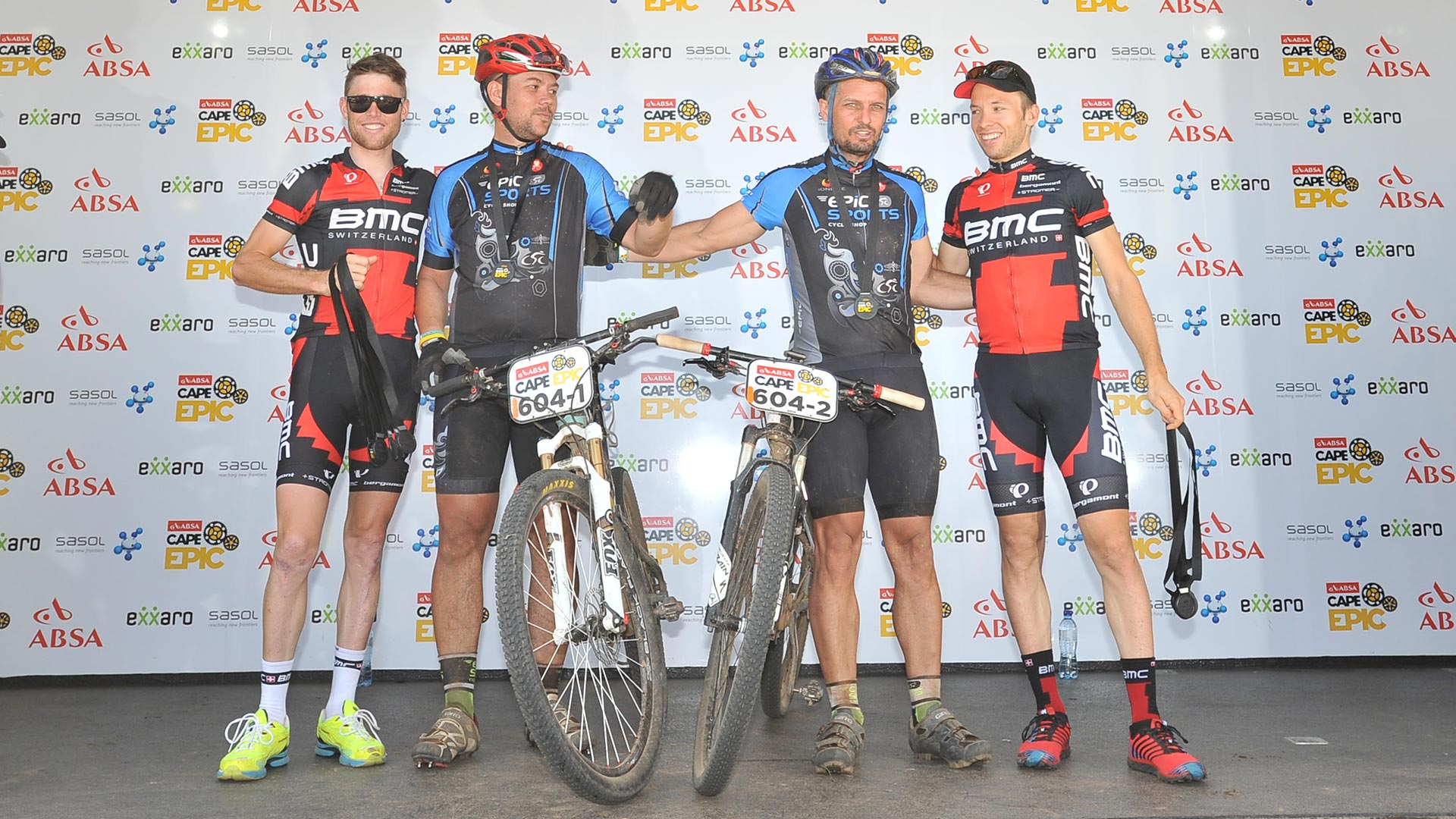 Coen van Tonder and another mountain biker at the award ceremony after the Cape Epic race